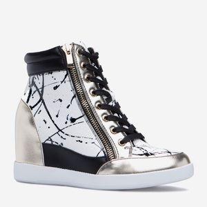 Black, white, and gold platform wedge sneaker